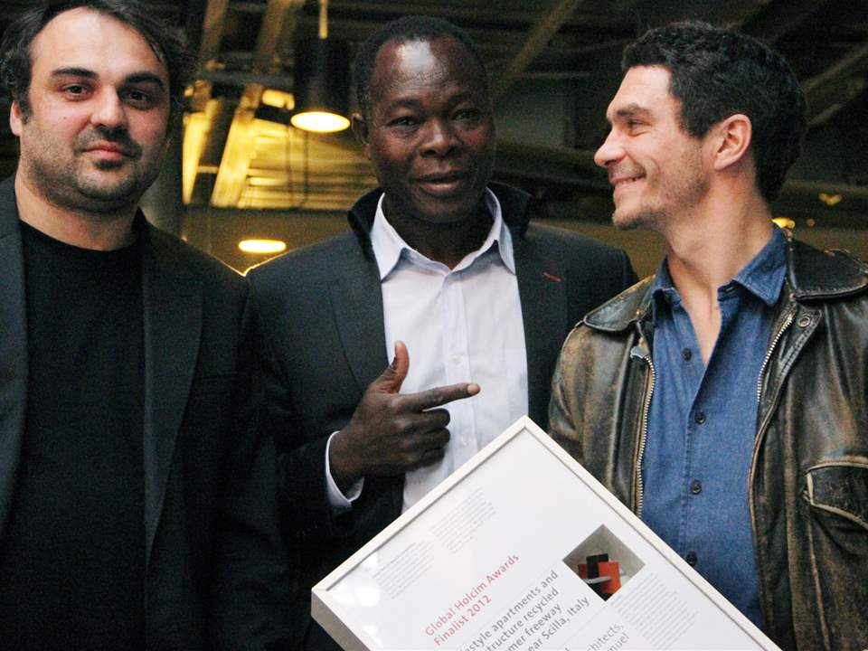 Global Holcim Awards Gold 2012 winner Francis Kéré (center) congratulates finalist certificate …
