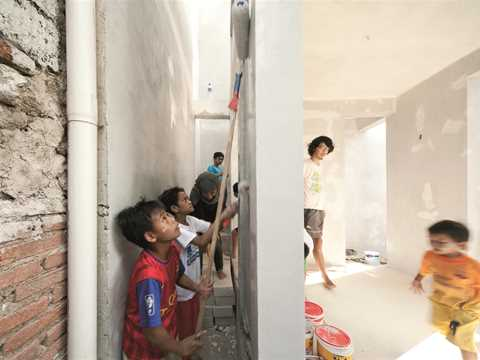 """""""Environmental Void"""" is painted white by community children."""