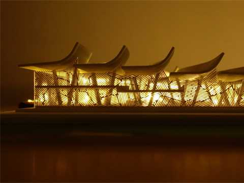 Elevation view of screen and roofline at night: A locally sourced bamboo and wood …